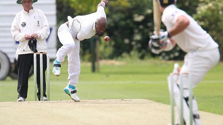 Tino Best bowls a delivery during Mildenhall's four-wicket win over Frinton on Saturday. Best took t