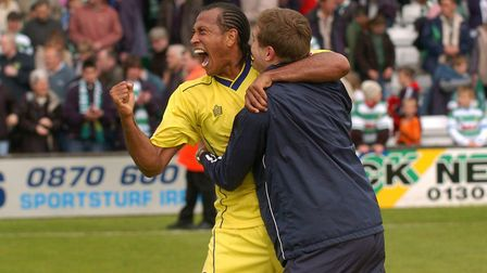 Chris Iwelumo celebrates promotion to the Championship with manager Phil Parkinson, following a 0-0