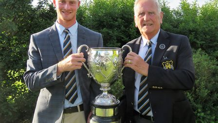 James Biggs receives the Todd Cup from Suffolk Golf Union president Colin Firmin after winning the S
