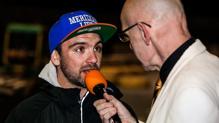 Kyle Newman talking with meeting presenter Kevin Long at Foxhall.