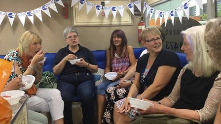 The Sudbury group enjoy cream teas on the Suffolk Family Carers bus. Picture: SUFFOLK FAMILY CARERS.