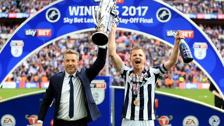 Millwall manager Neil Harris and captain Tony Craig celebrate with the trophy after the Sky Bet Leag