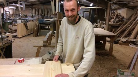 Graham Paris, a joiner at Peggs Joinery hand crafting a door for a customer