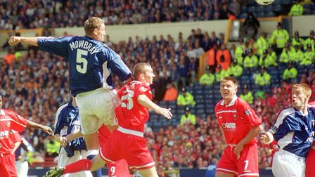 Tony Mowbray's towering header brought Town level in the 28th minute. Photo: Archant