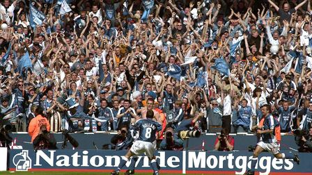 A topless Richard Naylor celebrates his goal with with skipper Matt Holland and thousands of jubilan