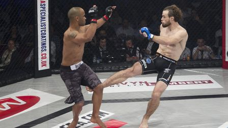 Corrin Eaton, right, fights for a K1 title at Contenders 19 on June 3