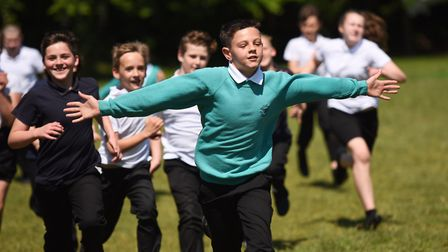 Pupils at Ravenswood Primary School take part in the Daily Mile. Picture: GREGG BROWN
