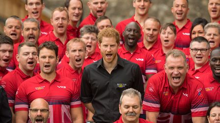 Prince Harry poses for a group photo with athletes as he attends the launch of the UK's Invictus Gam
