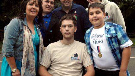 Colchester soldier Ashley Hall with friends and family in 2010. Picture: SARAH LUCY BROWN