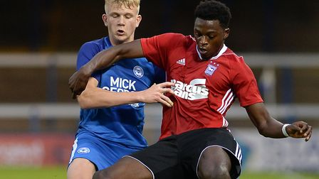 Dominic Iorfa in action against Peterborough shielding the ball from Lewis Freestone. Pictures: PAGE