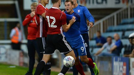 Things get a little un-friendly at the Abax Stadium as Tommy Smith takes exception to Peterborough's