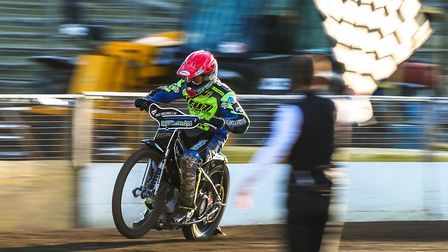 Danny King takes the chequered flag to win the opening heat against Sheffield last Thursday.