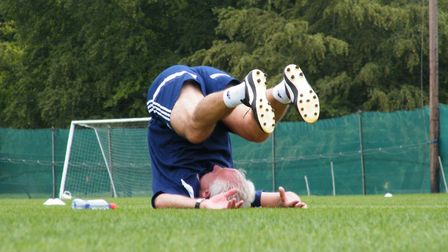 Ipswich Town boss Mick McCarthy finishes the session with some stretches of his own
