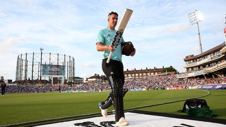 Surrey's Kevin Pietersen walks after losing his wicket for a score of 52 during the NatWest T20 Blas