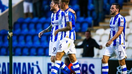 Denny Johnstone, left, celebrates with Frankie Kent after scoring the U's second goal in Tuesday nig