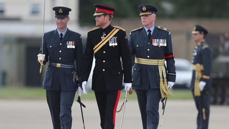Prince Harry inspects the honour guard as he arrives at RAF Honington in Suffolk where will present