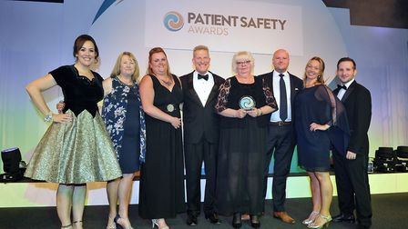 Members of the Care UK healthcare team at HMP Stafford collecting the company's trophy at the Patien
