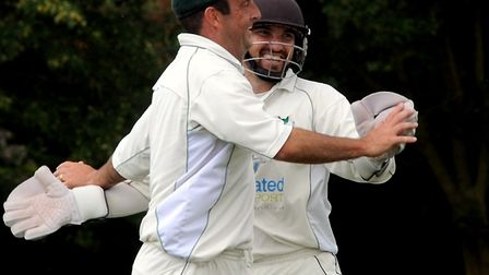 Barry Collins and wicketkeeper Karl Holmes celebrate the wicket of Tom Piddington. However, Woolpit