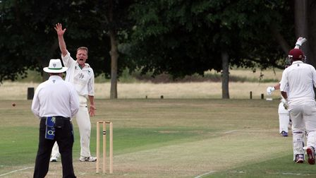 Woolpit bowler Rob Gibson has an appeal turned down during his side's defeat at Worlington. Picture:
