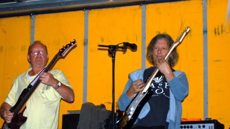 Rowland Higgins (right), playing with Village Green. Picture: HIGGIFEST