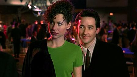 John Cusack as Martin Q Blank and Minnie Driver as his high school sweetheart Debi Newberry in the a
