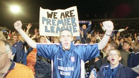 Town fans celebrate reaching the play-off final at Wembley.