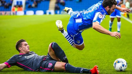 Drey Wright, sent flying by Morecambe's Aaron McGowan during the 2-2 draw last October, is staying w
