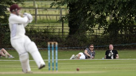 Olly Murs relaxes with a friend as he watches the Suffolk v Hertfordshire cricket match at Copdock.