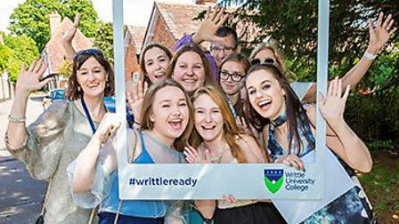 Writtle University College Further Education students celebrate with staff.