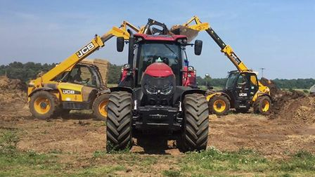 Senior Suffolk Young Farmers have been hard at work hauling muck to raise funds.