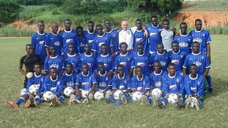 Ghana's Blues: Simon Milton with a squad of under-17 players proudly wearing their Ipswich Town stri