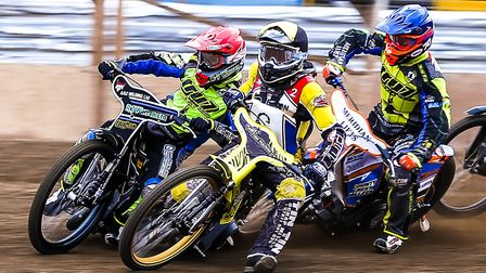 Danny King (red helmet), Tero Aarnio (yellow) and Kyle Newman (blue) battle in heat two of the Ipswi