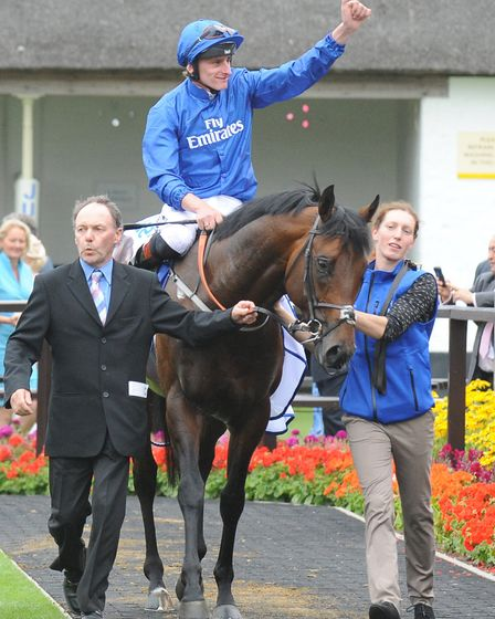 Harry Angel ridden by Adam Kirby celebrates winning The Darley July Cup at Newmarket. Photo: PA