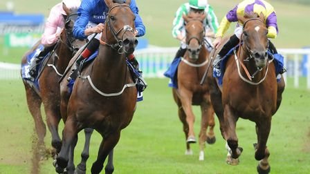Harry Angel ridden by Adam Kirby (left) wins The Darley July Cup at Newmarket. Photo: PA