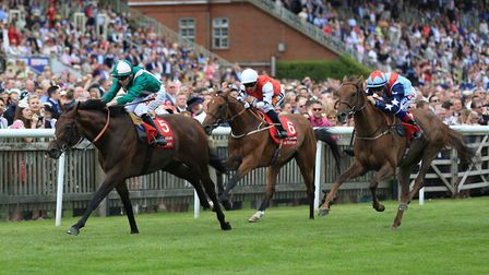 Raheen House ridden by Jamie Spencer wins The Bahrain Trophy Stakes during Ladies Day of The Moet an