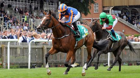 Clemmie (left) ridden by Ryan Moore wins The Duchess of Cambridge Stakes. Picture: PA SPORT