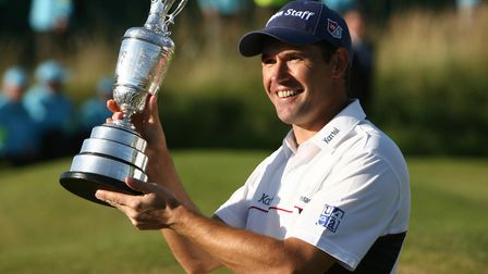 Republic of Ireland's Padraig Harrington celebrates with the trophy after winning the Open Champions