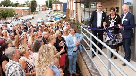 Ribbon cutting at Challs' new offices with (L to R) South Suffolk MP James Cartlidge, Mayor of Hadl