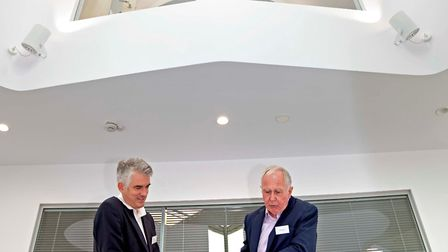 South Suffolk MP James Cartlidge and Challs MD Graham Burchell in the company's new office atrium