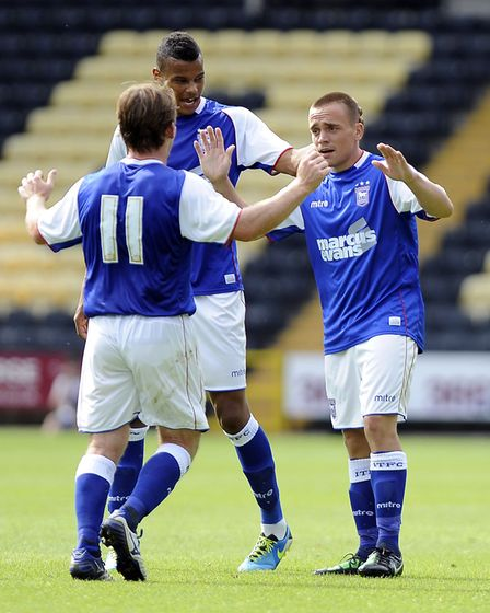 2013: Paul Taylor is congratulated after scoring in Ipswich Town's 3-3 draw with Notts County. Photo
