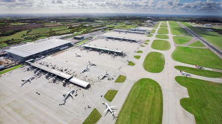 An aerial picture of Stansted Airport including part of the main runway, right