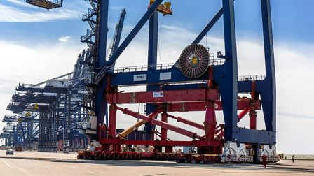 The first of 10 cranes to be raised at the Port of Felixstowe being moved into position for the upgr
