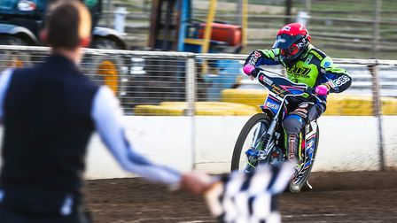 Cameron Heeps takes the chequered flag to win heat three against Newcastle.