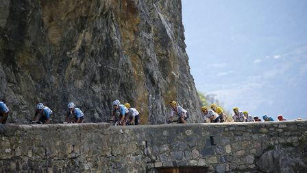 The group of leaders with Britain's Chris Froome, wearing the overall leader's yellow jersey, climbs