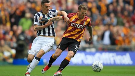 Charlton have signed former Ipswich Town striker Billy Clarke (right) from Bradford this summer. Pho