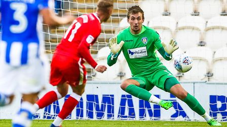Lee Martin puts Gillingham 1-0 ahead in the Gills' 2-1 victory at Colchester United tonight. Picture