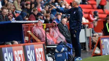 Ipswich Manager Mick McCarthy responds to something said by Charlton fans during the second half at
