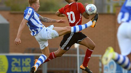 A last ditch lunging tackle from Frankie Kent stops Ipswich's David McGoldrick in last week's pre-se