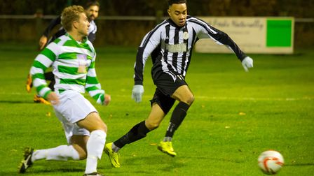 Woodbridge Town's Callum Sinclair, right, in imperious form at Wisbech
