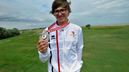 Paul Waring shows off his silver medal from the Deaflympics. Picture: TONY GARNETT